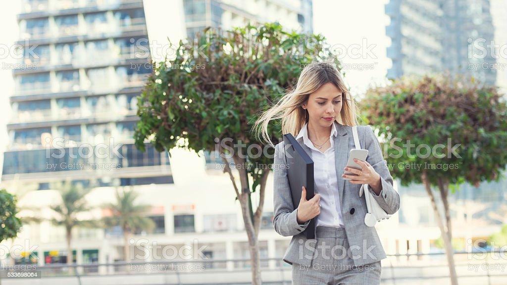 Businesswoman texting in Dubai stock photo