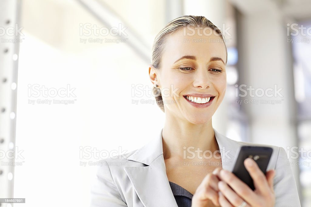 Businesswoman Texting on a Cellphone royalty-free stock photo