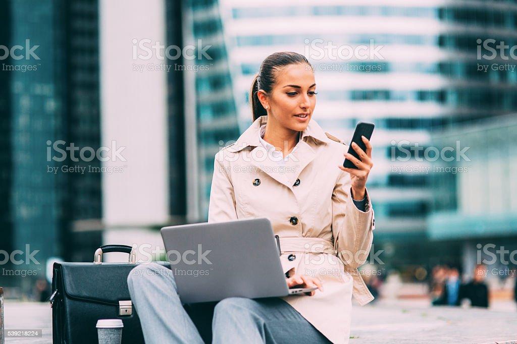 Businesswoman texting stock photo