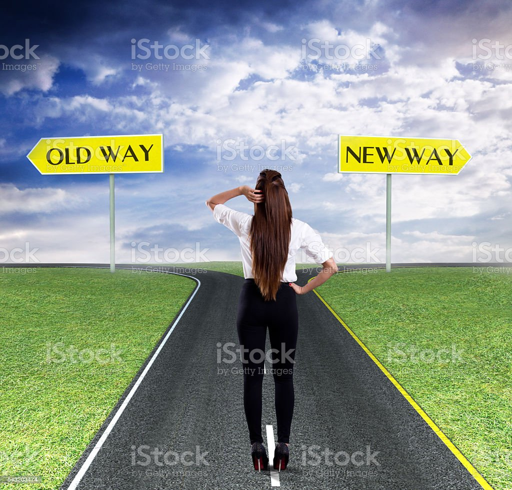 Businesswoman thinking about old way or new way stock photo