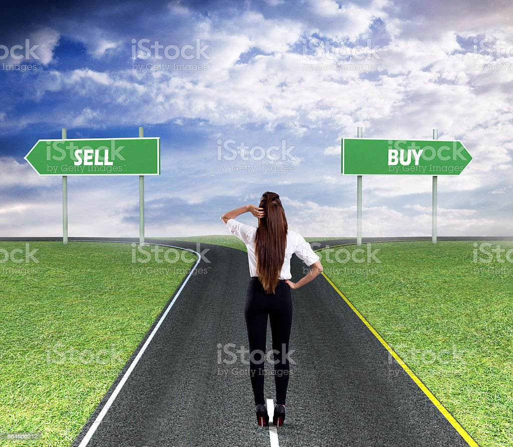 Businesswoman thinking about Sell or Buy stock photo