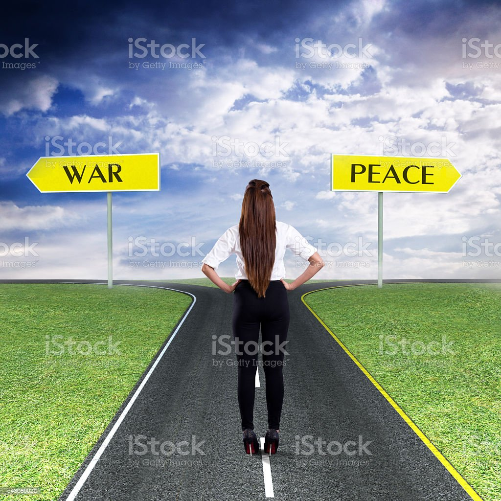 Businesswoman thinking about War or Peace stock photo