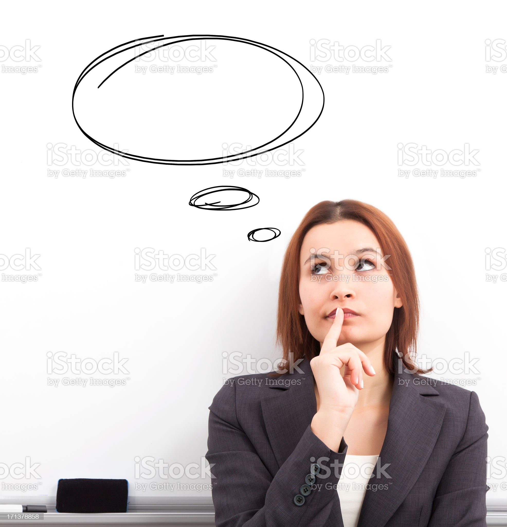 Businesswoman thinking of a concept royalty-free stock photo