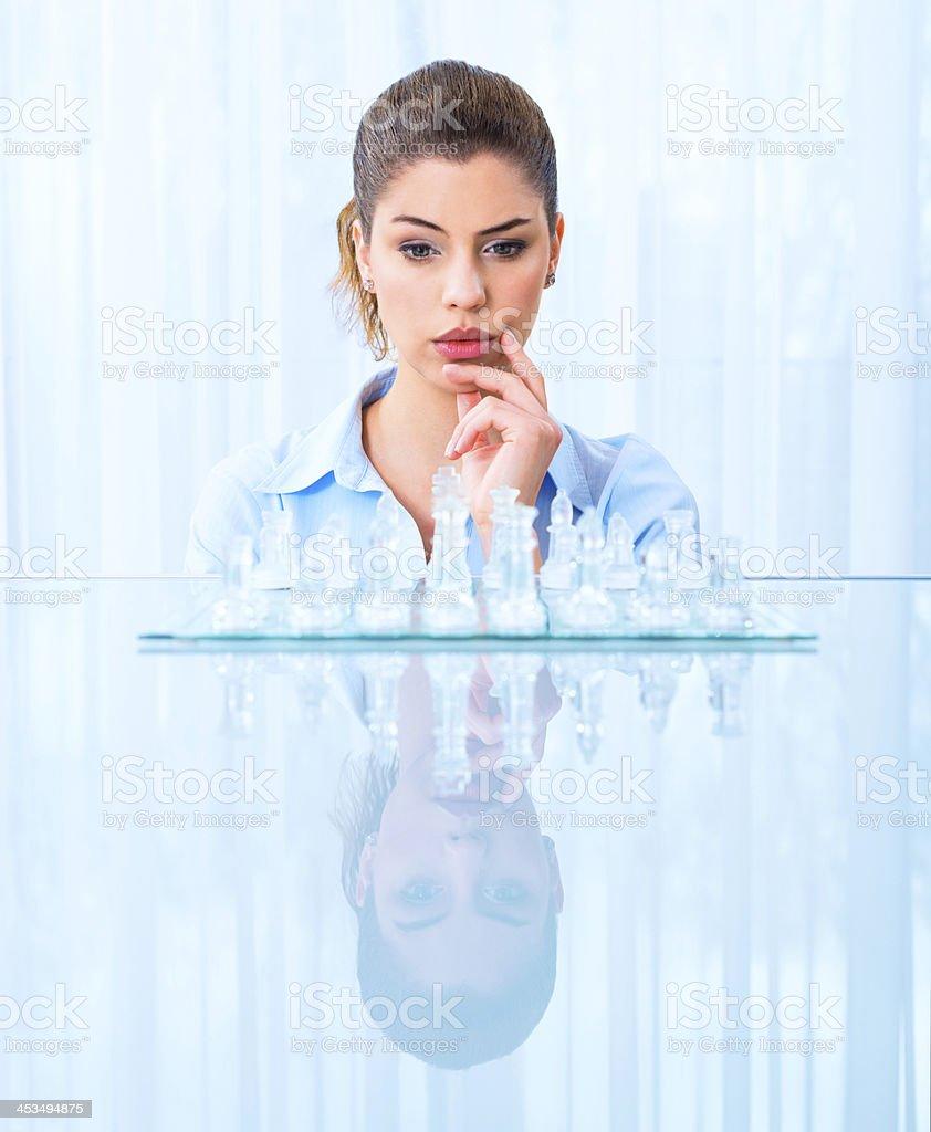 Businesswoman thinking on next move royalty-free stock photo