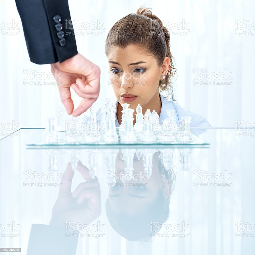 Businesswoman thinking on next move stock photo