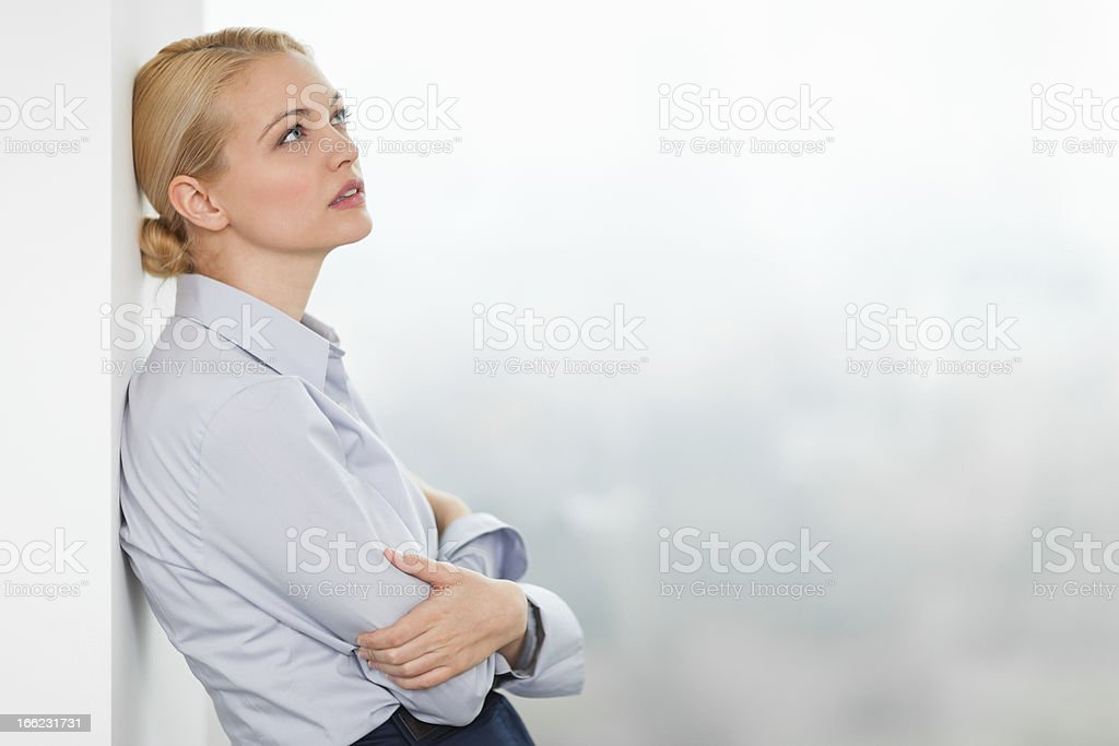 Businesswoman thinking royalty-free stock photo