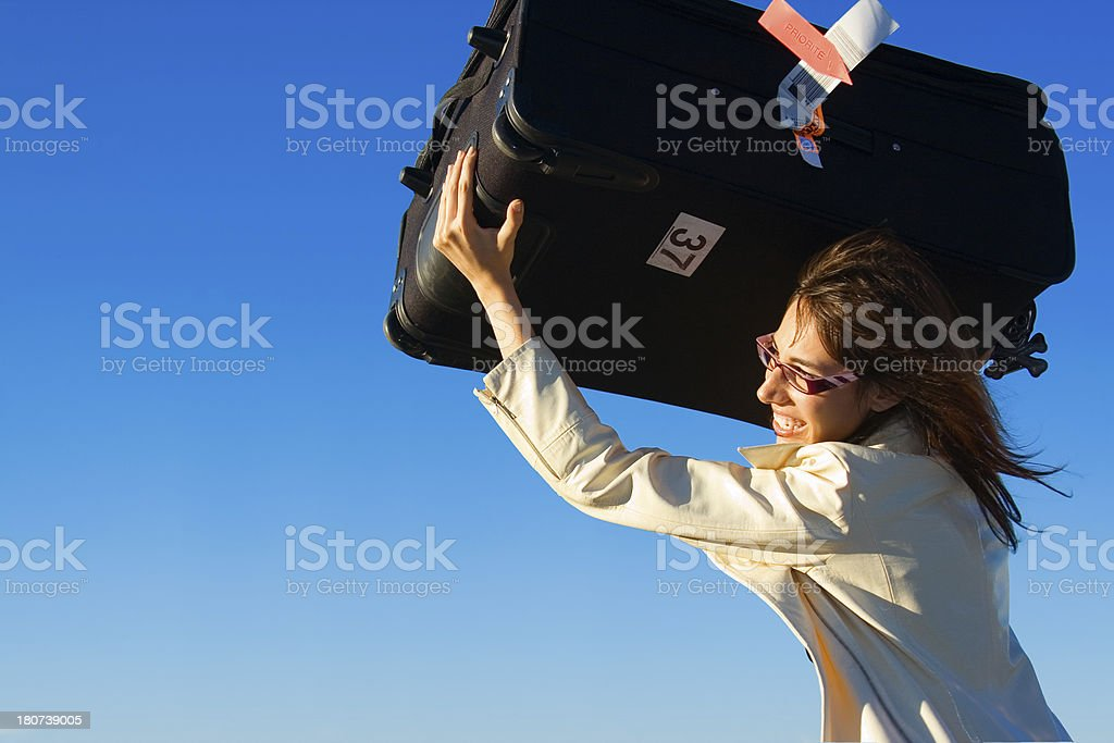 Businesswoman Throwing Luggage Bag royalty-free stock photo