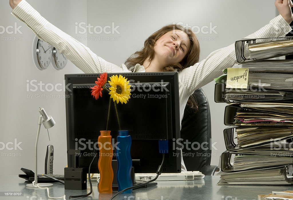 businesswoman tired of working late royalty-free stock photo