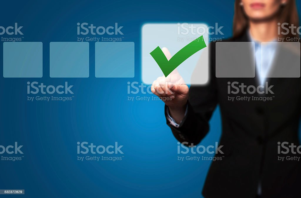 Businesswoman Touching Button and Ticking Check Box stock photo