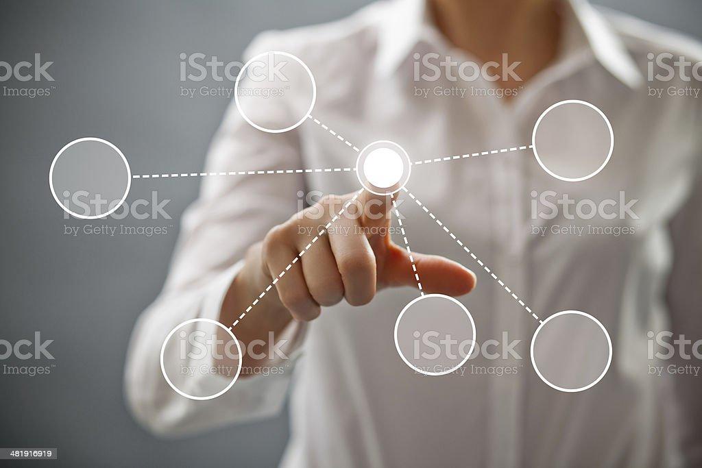 Businesswoman touching button royalty-free stock photo