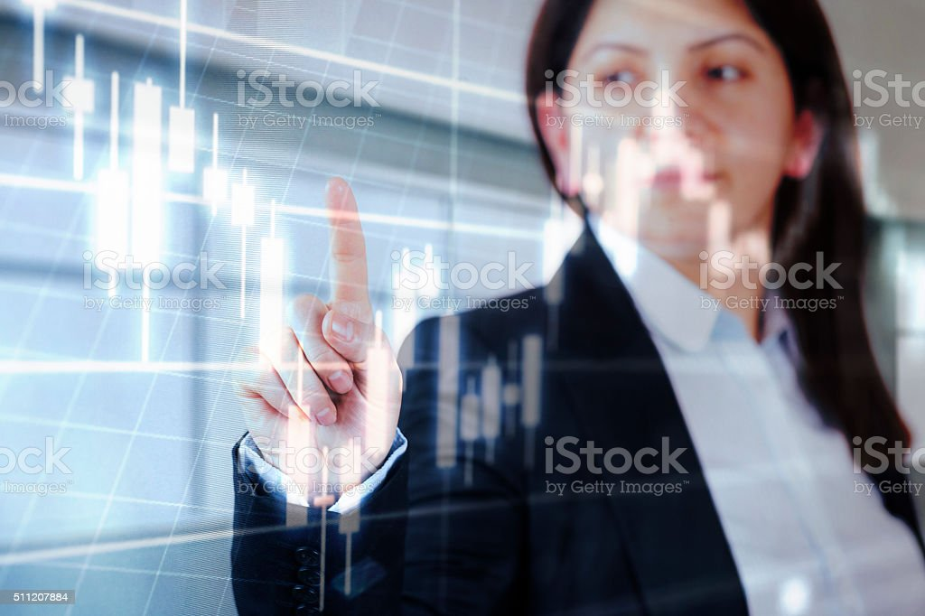 Businesswoman touching financial dashboard stock photo