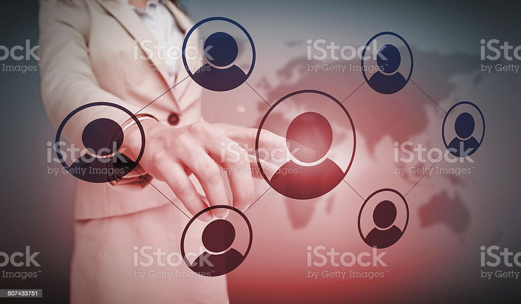Businesswoman touching futuristic social network interface with red glow stock photo