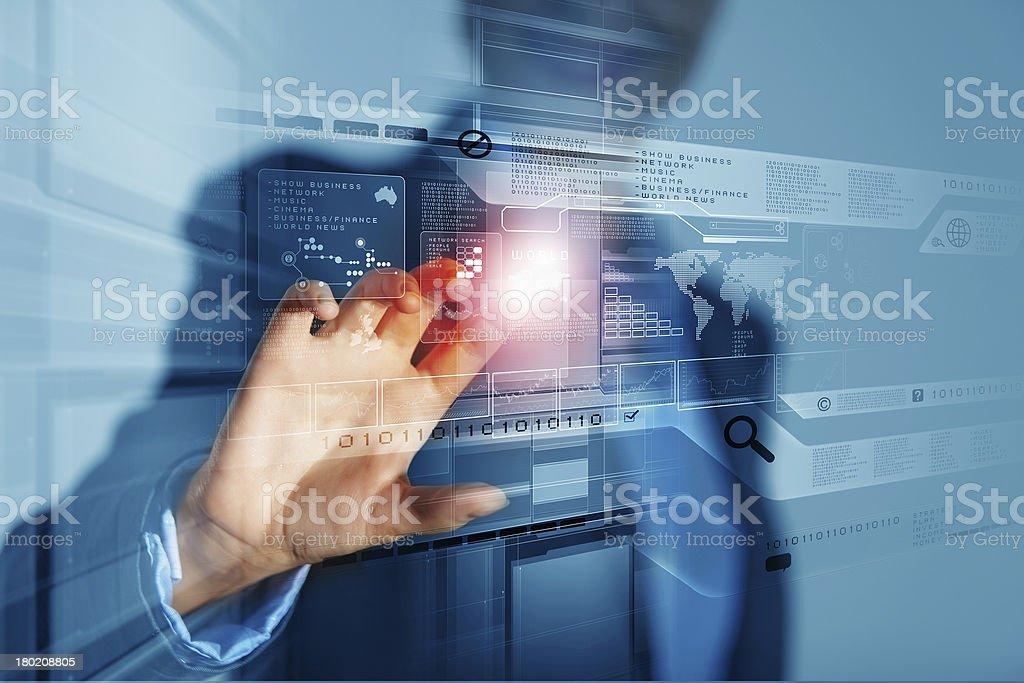 Businesswoman touching icon stock photo