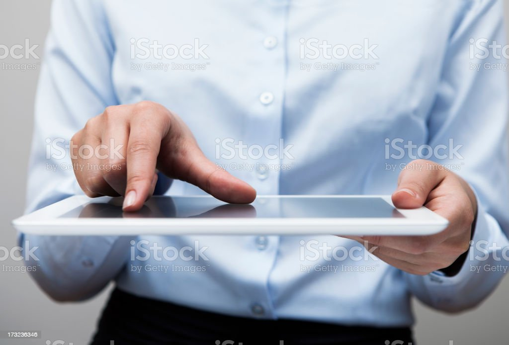Businesswoman touching Tablet pc screen royalty-free stock photo