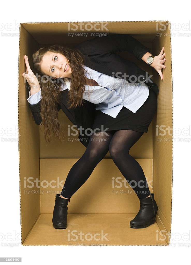 Businesswoman trapped in a cardboard box royalty-free stock photo