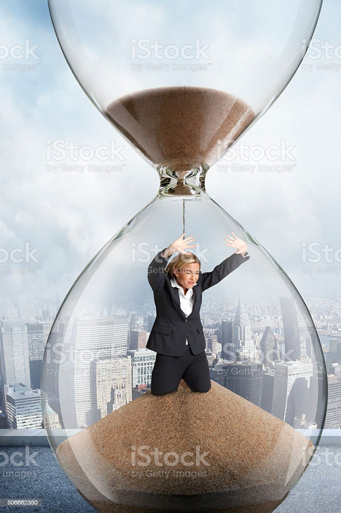 Businesswoman Trapped Inside An Hourglass stock photo