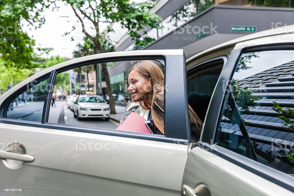 Businesswoman travelling by car in downtown stock photo
