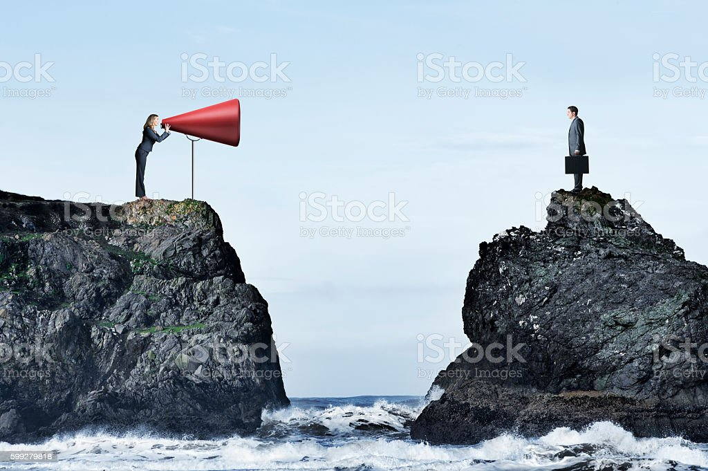 Businesswoman Trying To Communicate With Businessman stock photo