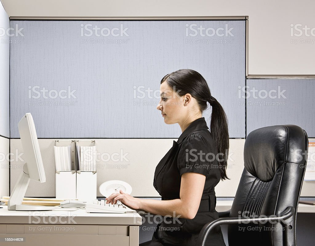 Businesswoman Typing on Computer at Desk royalty-free stock photo