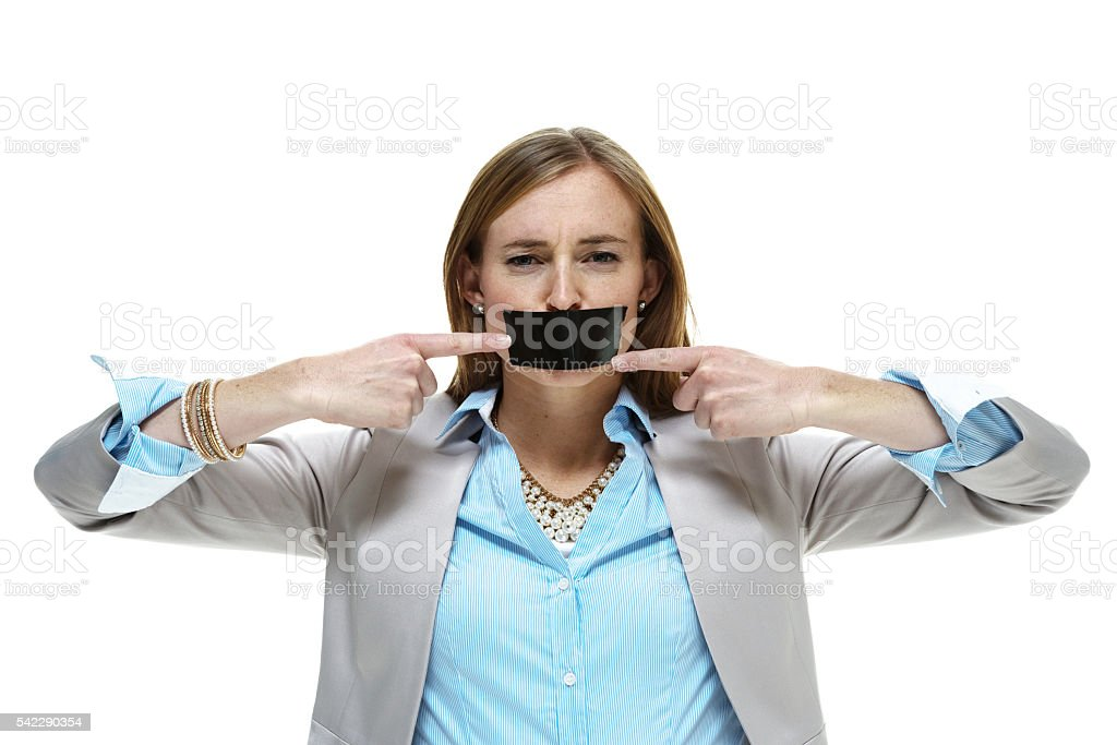 Businesswoman unable to speak her mind stock photo