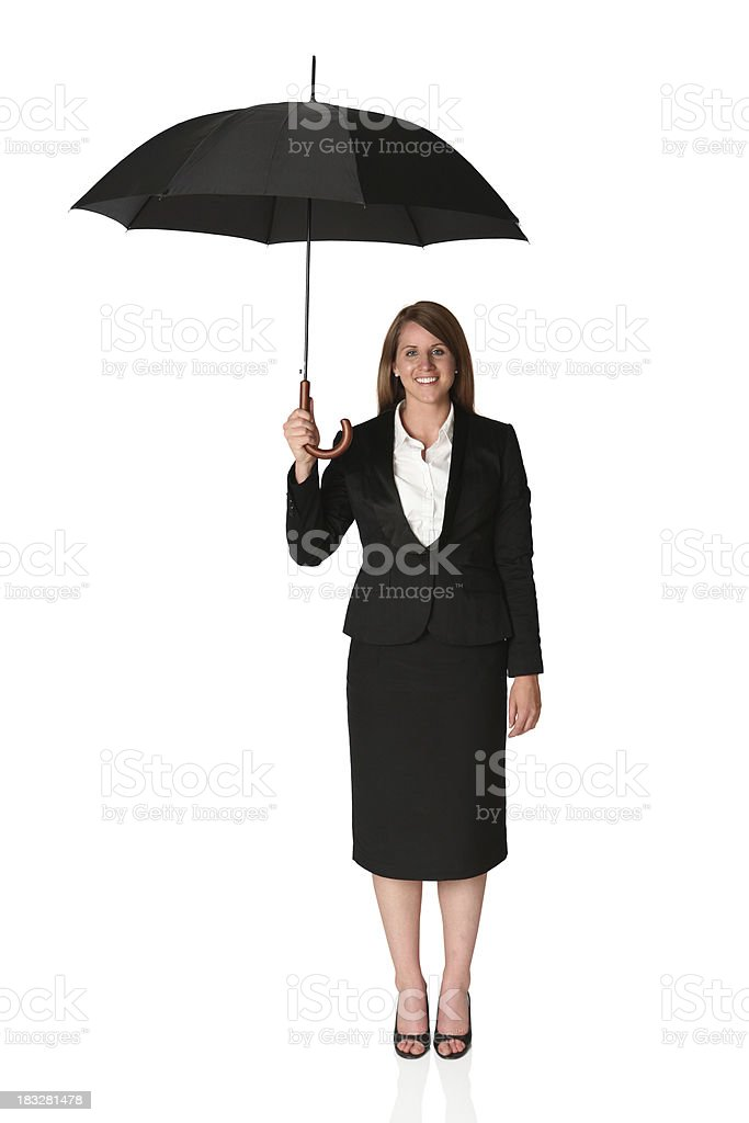Businesswoman under an umbrella royalty-free stock photo