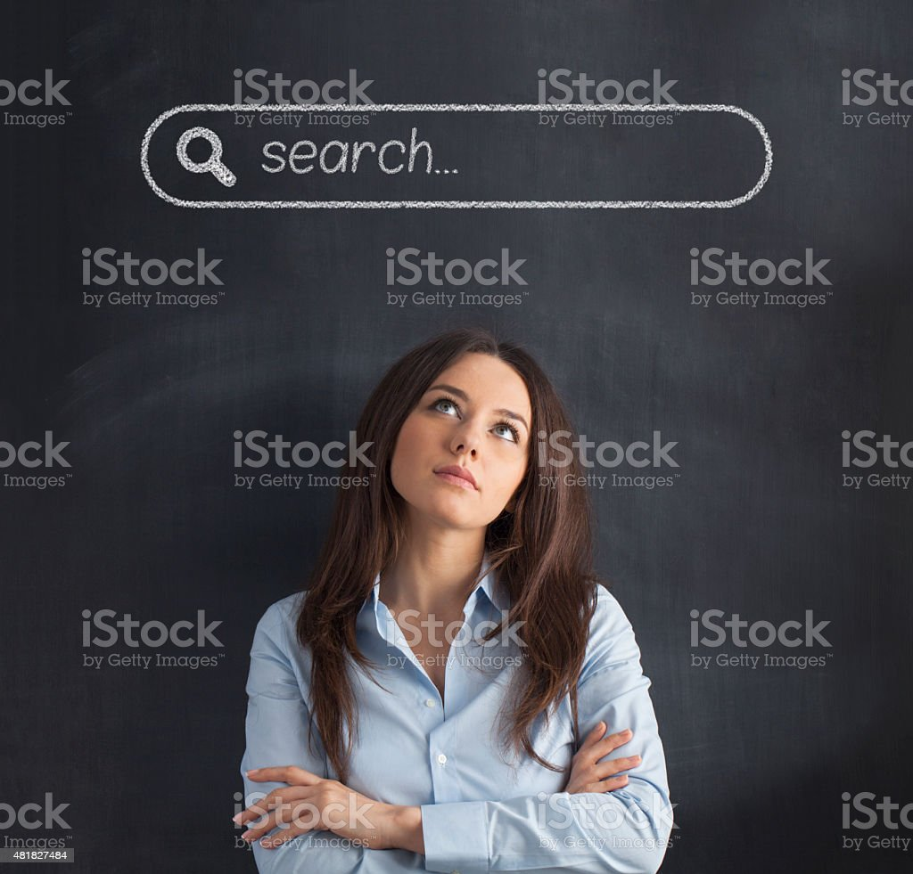 Businesswoman under the search bar stock photo