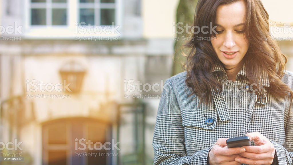 Businesswoman use her mobile phone stock photo
