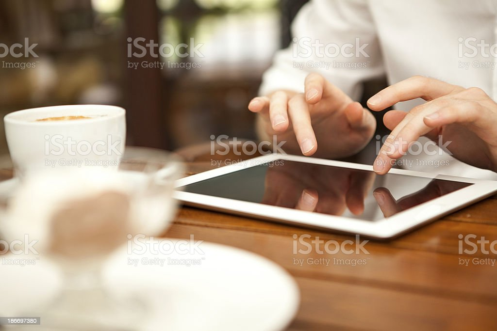 Businesswoman uses digital tablet royalty-free stock photo