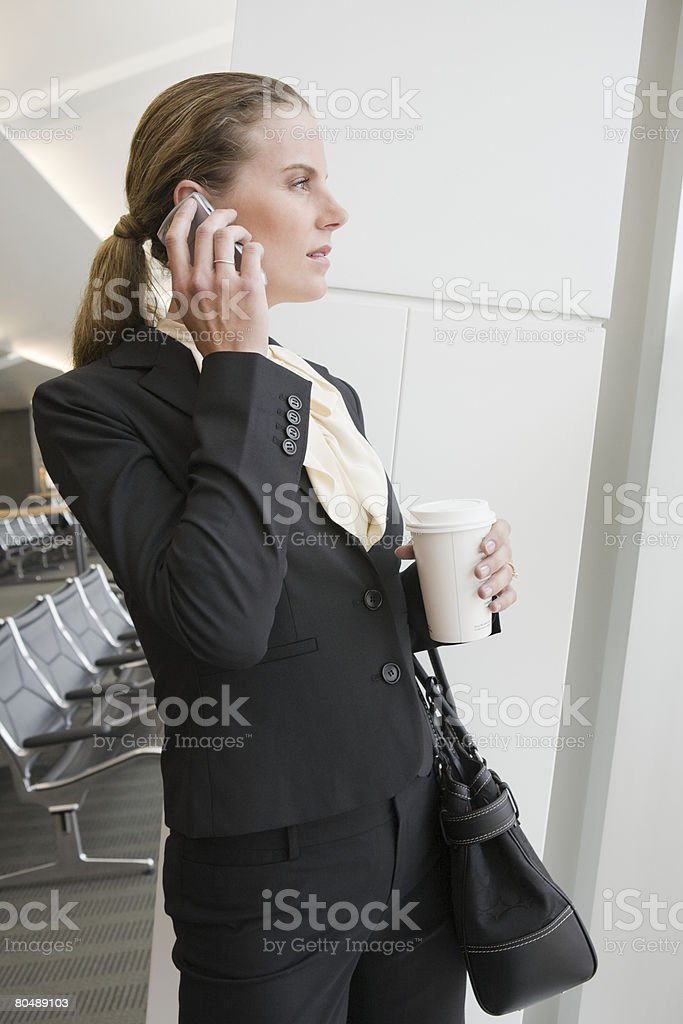 A businesswoman using a cell phone royalty-free stock photo