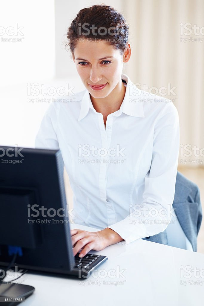 Businesswoman using a computer royalty-free stock photo