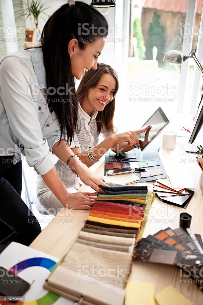 Businesswoman using a digital tablet in an office stock photo