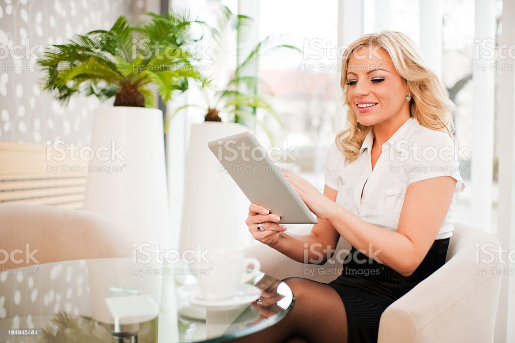 Businesswoman using a digital tablet. royalty-free stock photo