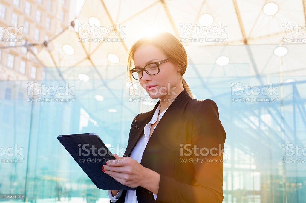 Businesswoman using a digital tablet stock photo
