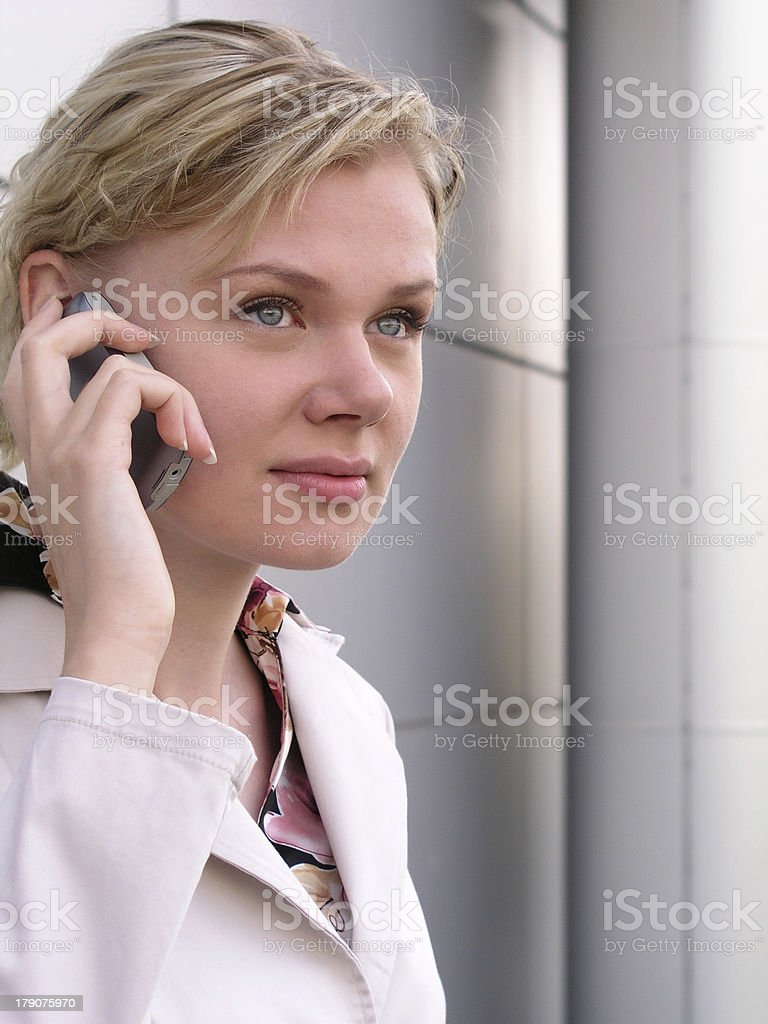 Businesswoman using a mobile phone royalty-free stock photo