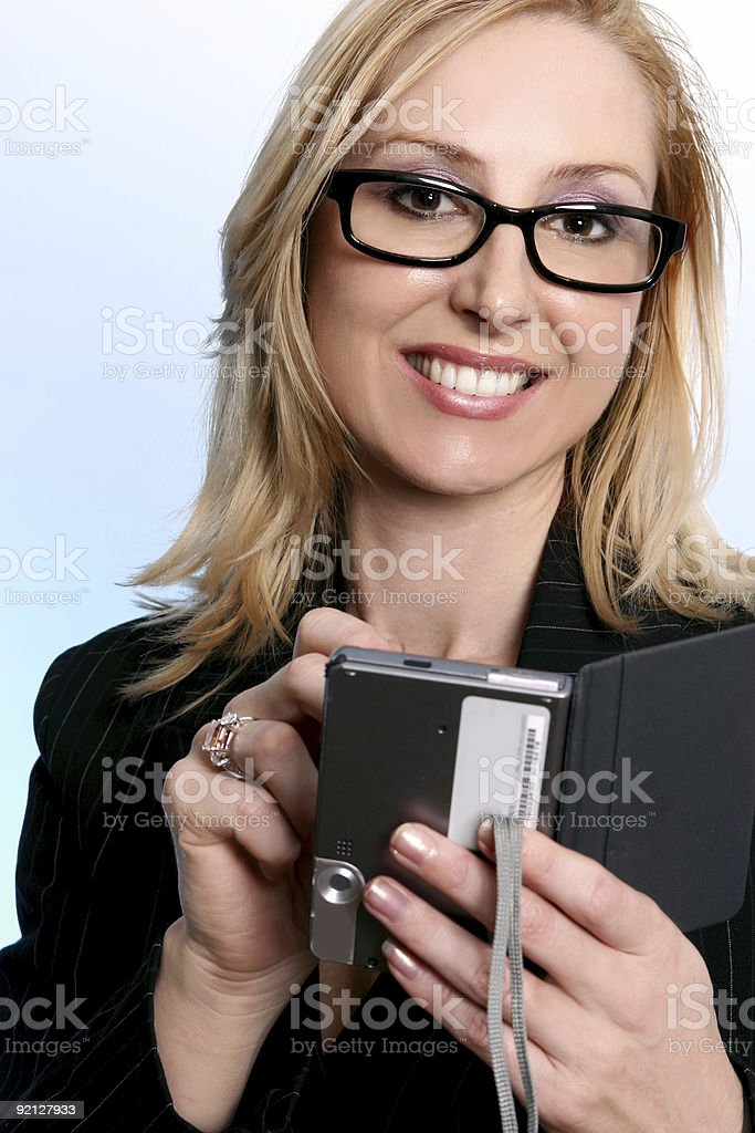 Businesswoman using a pda organizer royalty-free stock photo