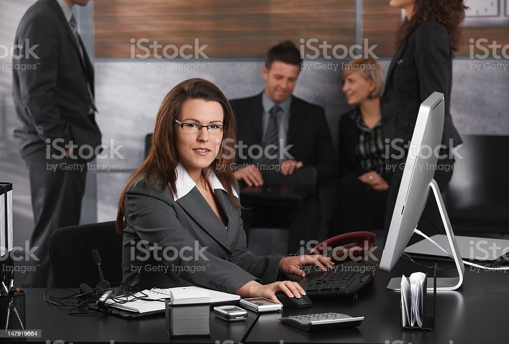 Businesswoman using computer royalty-free stock photo