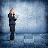 Businesswoman Using Digital Tablet Stands On Chessboard Surface