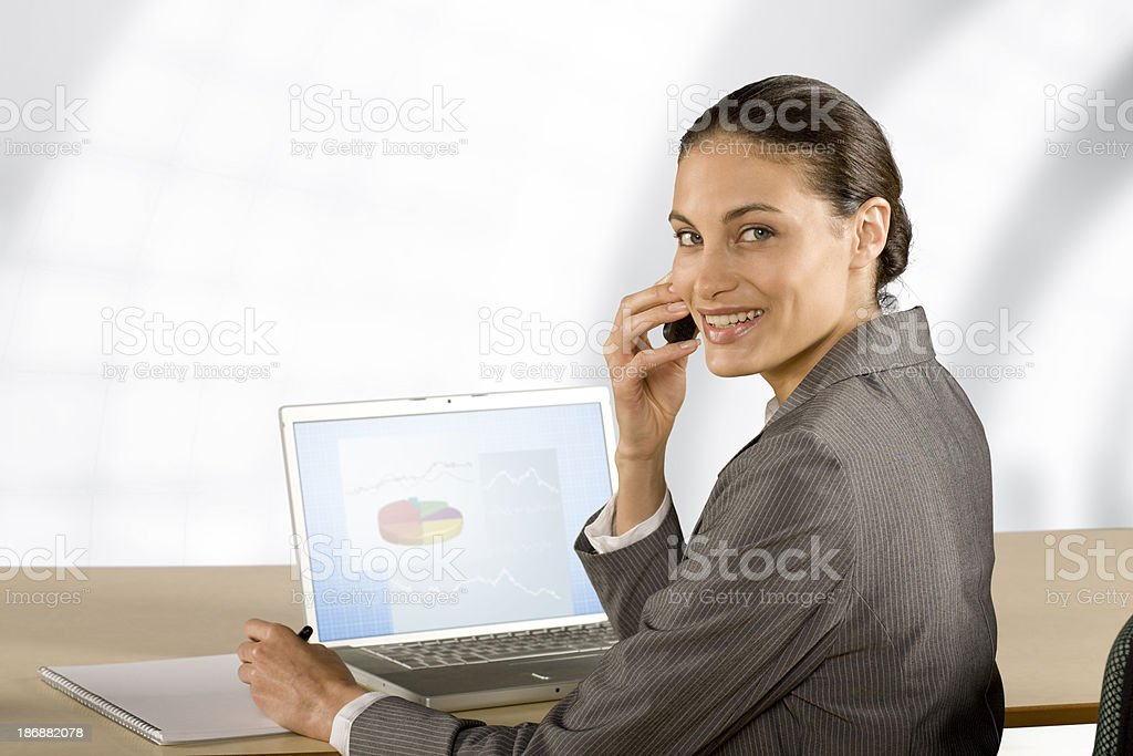 Businesswoman Using Laptop and Cellphone royalty-free stock photo