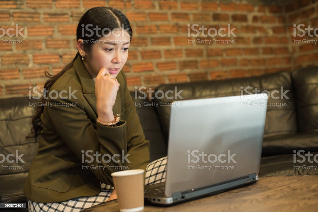 Businesswoman using laptop computer in coffee shop stock photo
