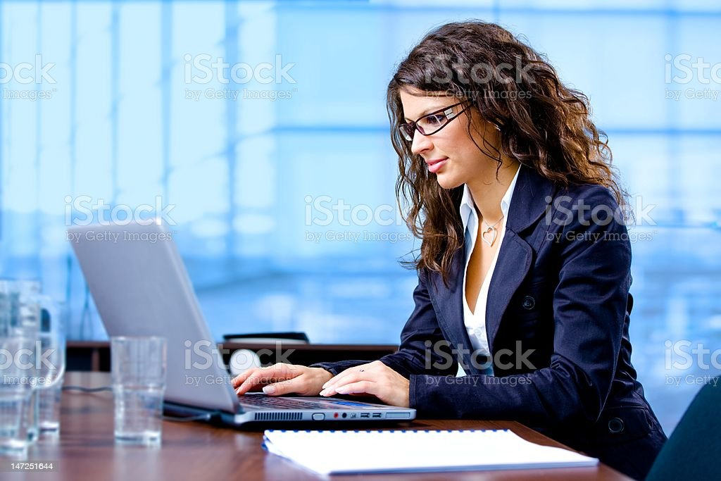 Businesswoman using laptop royalty-free stock photo