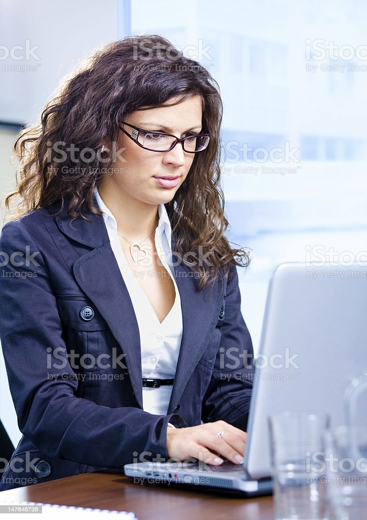 Businesswoman using laptop royalty-free stock photo
