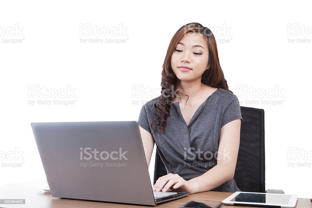 Businesswoman using laptop stock photo