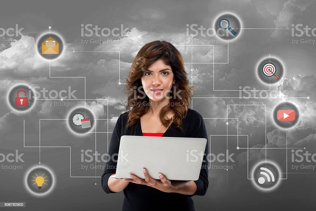 Businesswoman using laptop stock photo