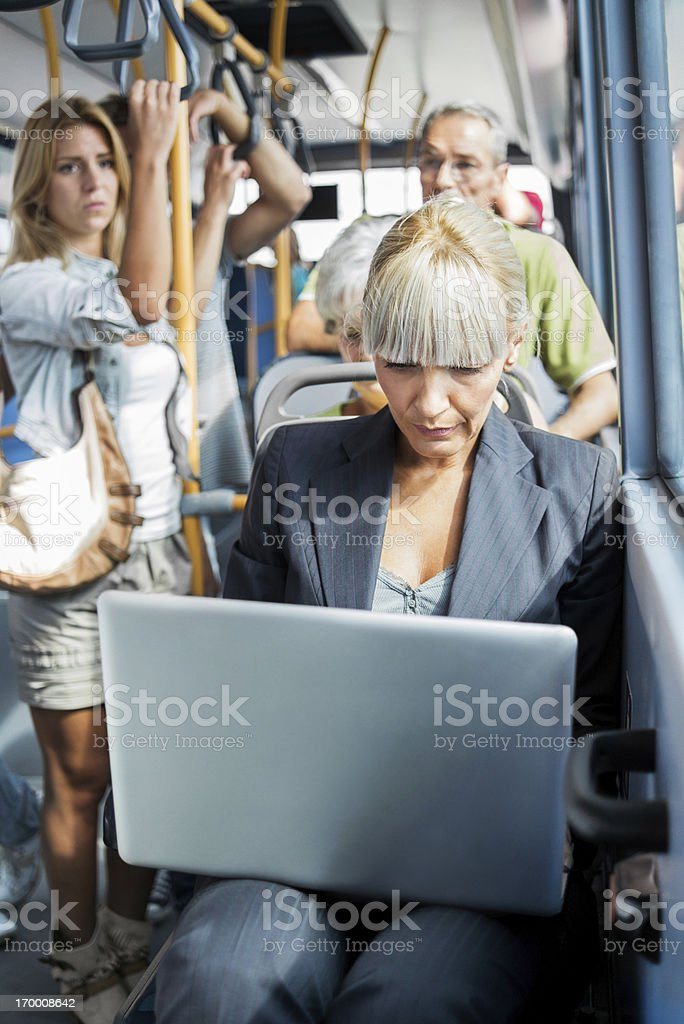 Businesswoman using laptop while commuting to work. royalty-free stock photo
