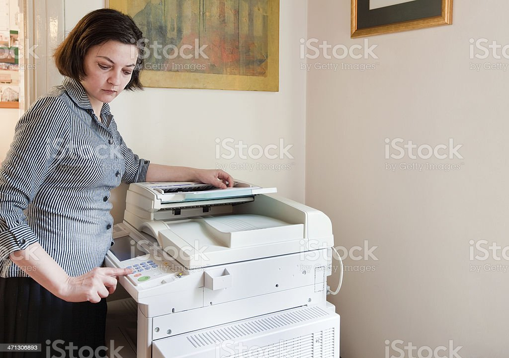 Businesswoman using multifunction device royalty-free stock photo