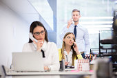 Businesswoman using smart phone at desk in office