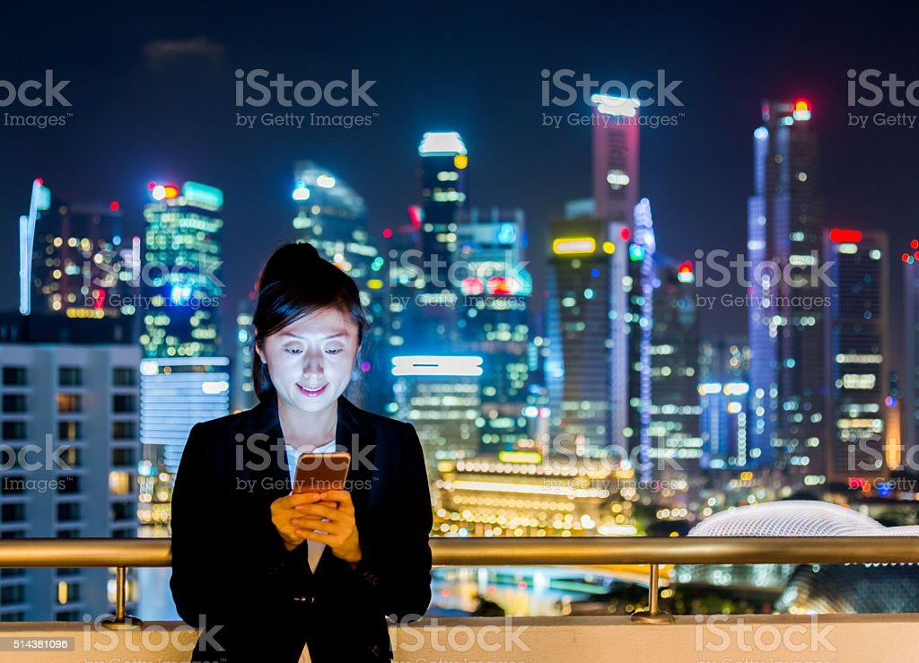 Businesswoman using smart phone stock photo