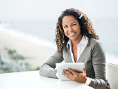 Businesswoman using touchpad.