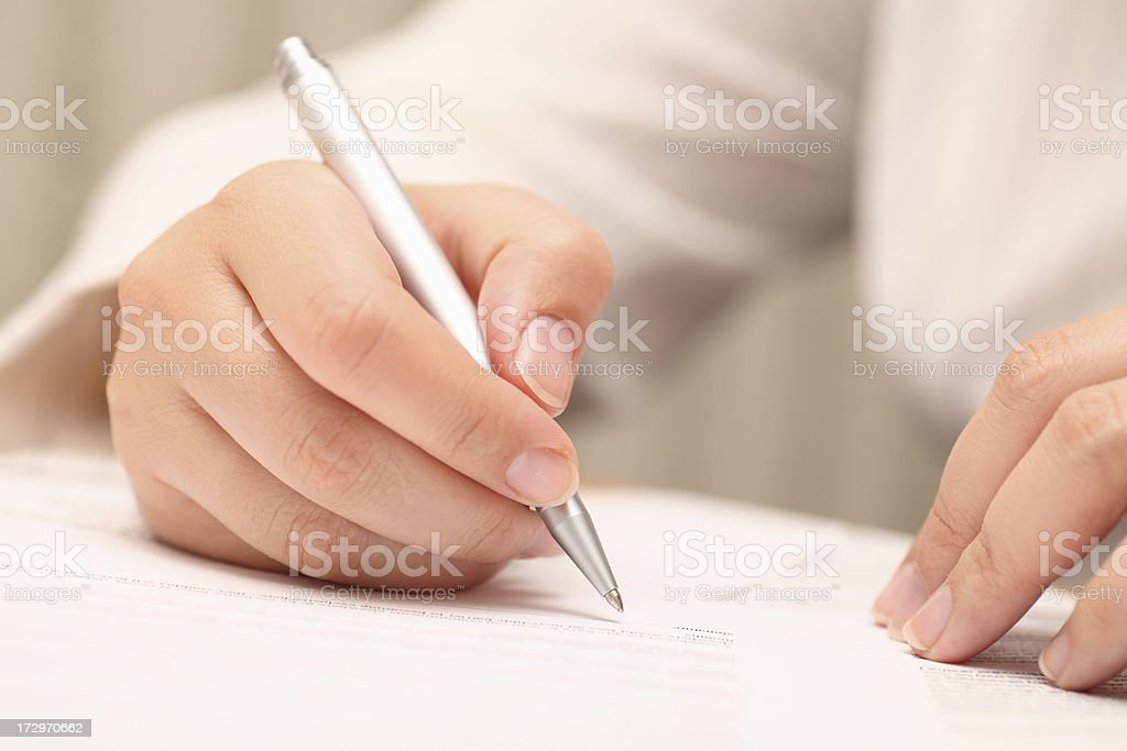 Businesswoman viewing the contract before signing royalty-free stock photo