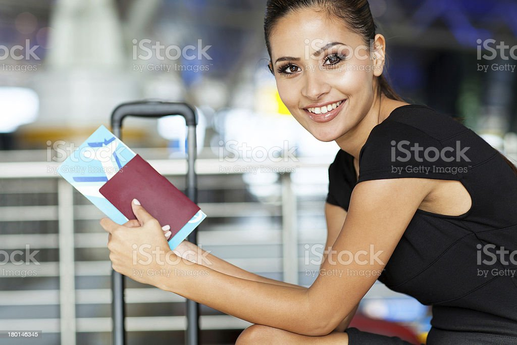 businesswoman waiting for flight stock photo